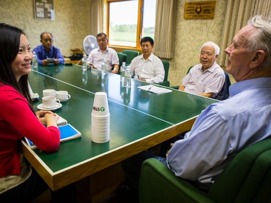 Seed entrepreneur Harry Stine's Adel-based business is the world's largest privately held seed company. Stine(right), shown here at his Adel, Iowa, offices Wednesday, Aug 13, 2014, meets with Li Zhao, president of China operations of China Iowa Group, left, and a contingent from Chinese Academy of Agricultural Scientists in Beijing. Rodney White/Pulitzer Center/The Des Moines Register