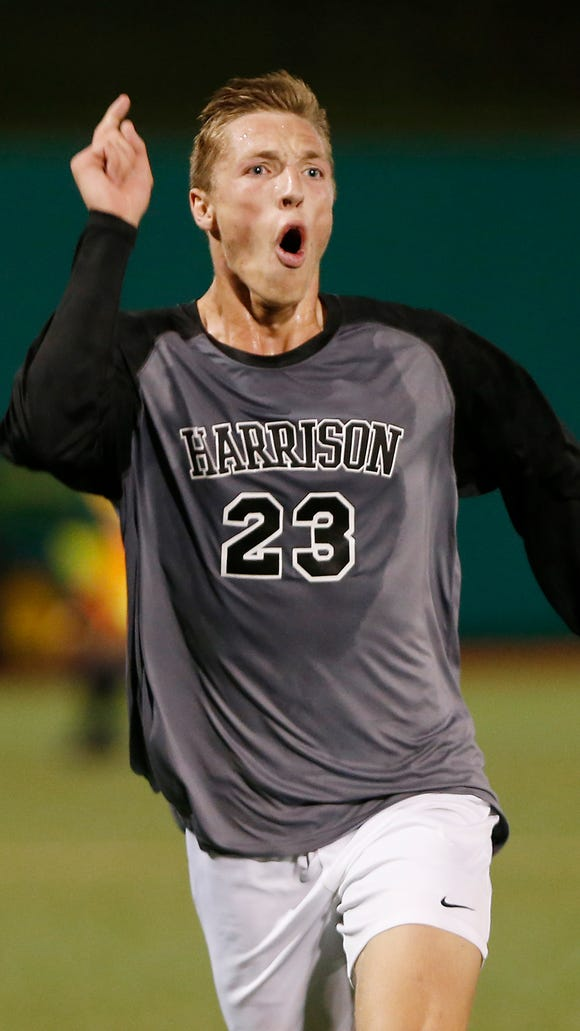 Jakub Hall of Harrison reacts after his goal with 9:12
