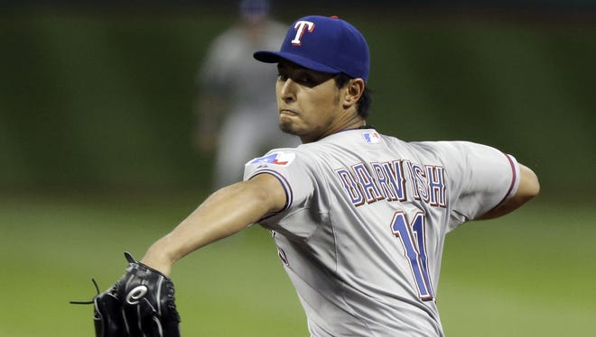 MLB is looking  into Rangers' pitcher Yu Davish's relationship with his brother who was charged with running an illegal gambling ring  in Japan.