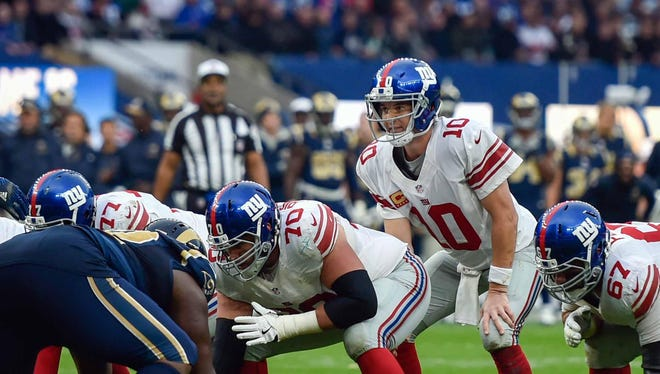 Quarterback Eli Manning prepares for the snap during the fourth quarter of Sunday's game against the Los Angeles Rams.