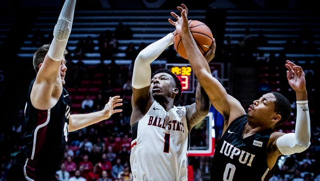 Ball State's Jontrell Walker looks to shoot past IUPUI's defense during their game at Worthen Arena Saturday, Dec. 2, 2017.