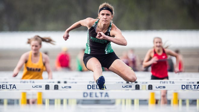 Yorktown's Hannah Rapp finishes first in the 100 meter hurdles during the Delaware County Track and Field Championship at Delta High School Friday, May 4, 2018.