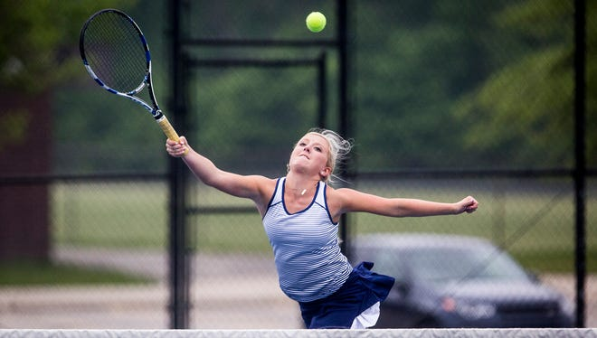 Delta's Lexie Manor hits against Yorktown during a doubles match at Delta High School Friday, May 18, 2018.