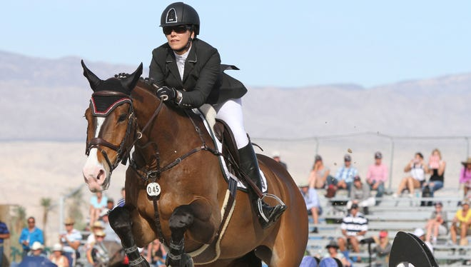 Susan Artes of South Pasadena competes in the $1 million Grand Prix horse jumping competition at the HITS Desert Horse Park in Thermal on Sunday.