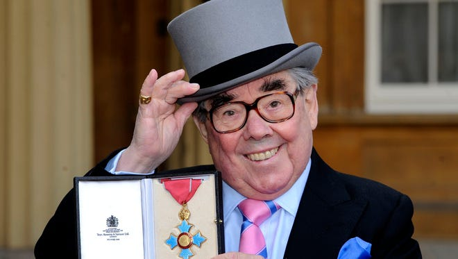 Scottish comedian Ronnie Corbett shows off his Commander of the British Empire medal in 2012 at Buckingham Palace.