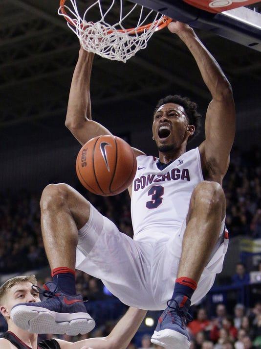 Gonzaga forward Johnathan Williams dunks during the first half of the team's NCAA college basketball game against Santa Clara in Spokane, Wash., Saturday, Feb. 4, 2017. (AP Photo/Young Kwak)