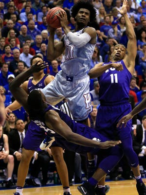 Kansas guard Josh Jackson was charged with misdemeanor criminal damage after allegedly vandalizing a woman's car outside a Lawrence bar.