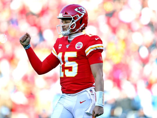 Jan 19, 2020; Kansas City, Missouri, USA; Kansas City Chiefs quarterback Patrick Mahomes (15) reacts after a touchdown during the first half against the Tennessee Titans in the AFC Championship Game at Arrowhead Stadium. Mandatory Credit: Mark J. Rebilas-USA TODAY Sports