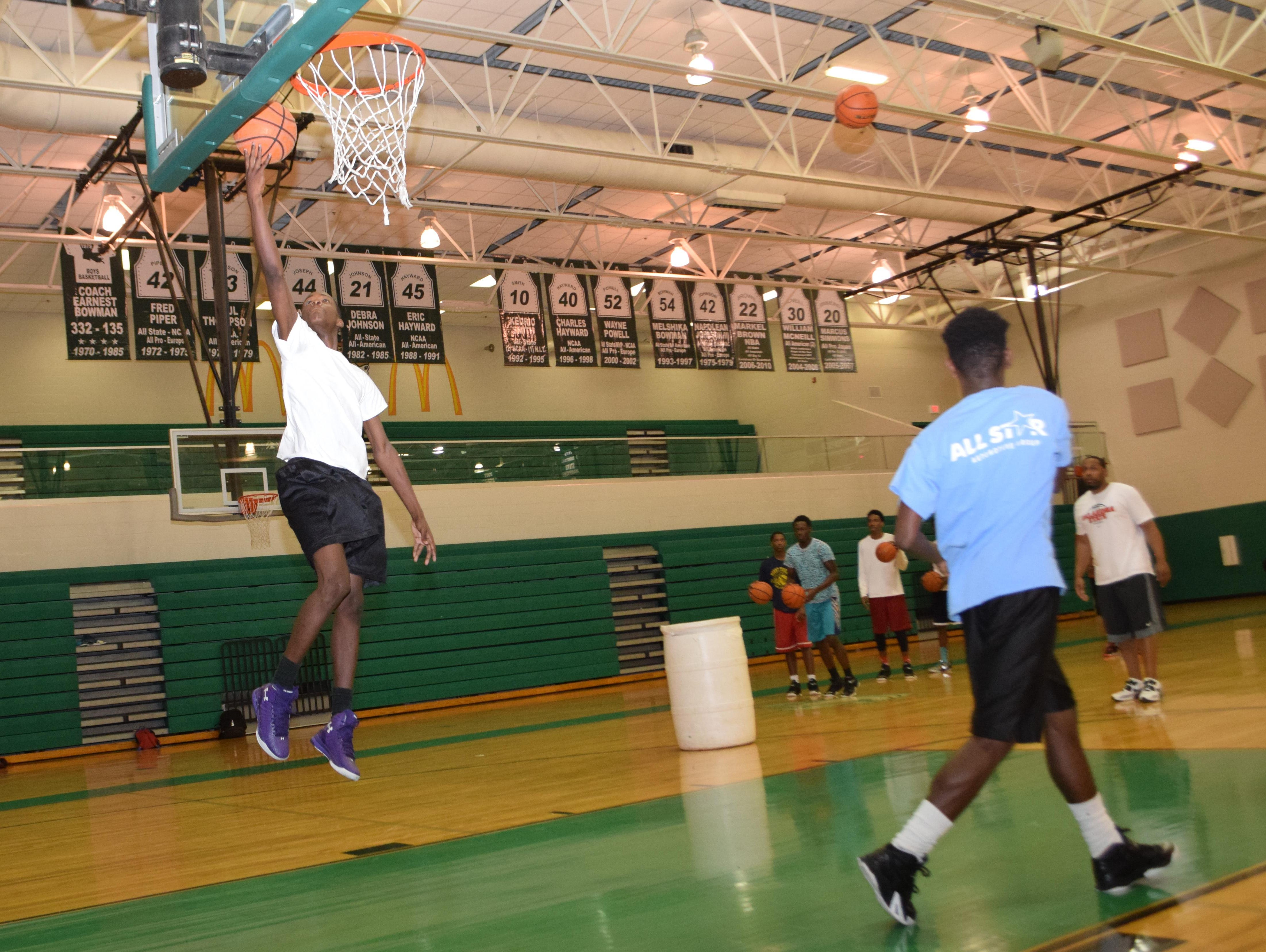 Peabody's Darius Smith (left) practices with the rest of the Peabody team Wednesday. The Peabody Magnet High School basketball team won the Houston National Summer Showcase.