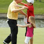 David Toms is greeted by 13-year-old son Carter and 5-year-old daughter Anna after winning the Crowne Plaza Invitational at Colonial in Fort Worth, Texas in 2011.