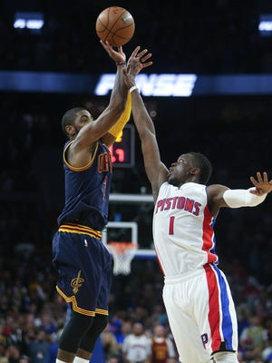 Pistons guard Reggie Jackson defends against Cavaliers guard Kyrie Irving during the fourth period Sunday at the Palace.