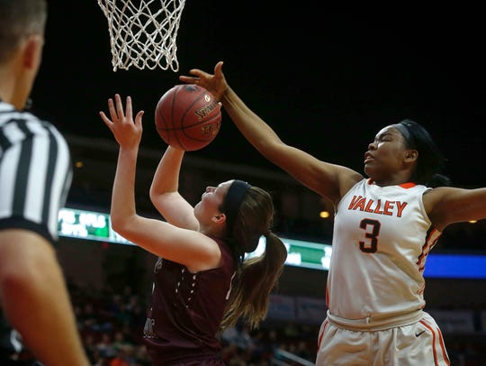 Valley High sophomore Zoe Young blocks a shot against