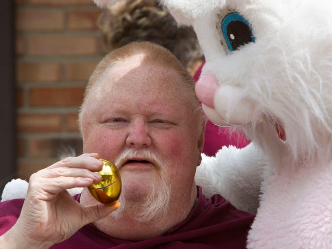 Resident David Majors shows the Easter Bunny a golden egg he found during the Heritage Healthcare Easter Egg Hunt Thursday, April 17, 2014, at the facility in West Lafayette.