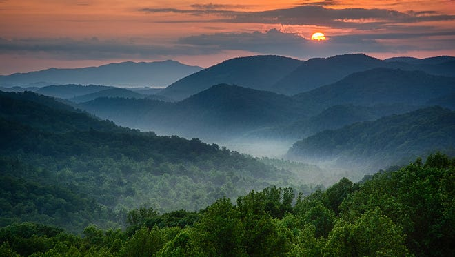Sunrise at Great Smoky Mountains National Park: It's just gorgeous. As the sun peeks over the clouds, the fog begins to lift off the mountains.