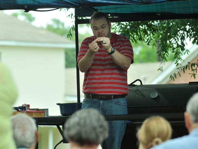 Stacey Little gives a cooking demonstration during Prattville Farmer's Market on Saturday, June 7, 2014, in 'the grove' across from the Gillespie Senior Center.