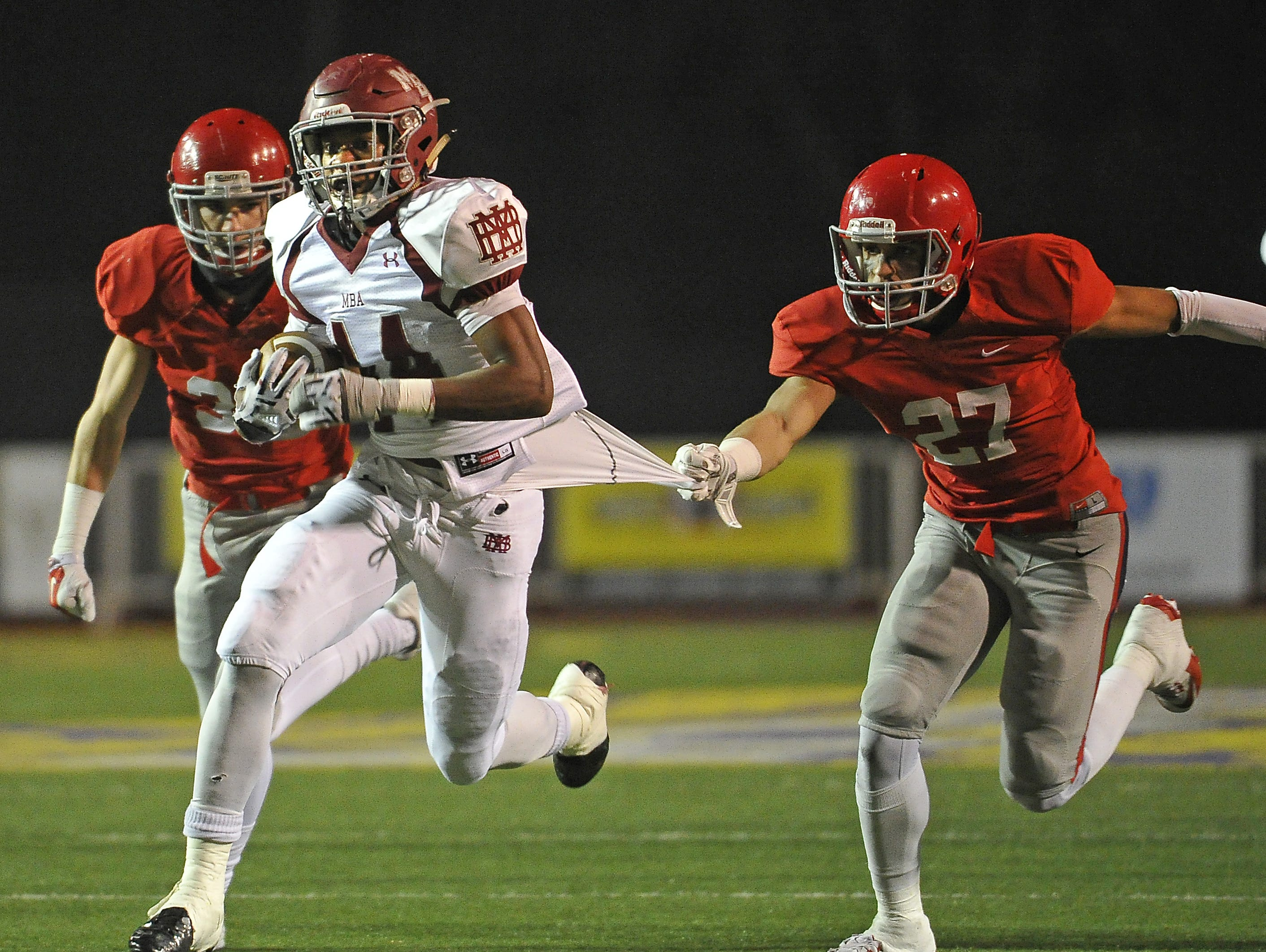 MBA's Ty Chandler breaks free of Brentwood Academy's Cam Johnson during the BlueCross Bowl.