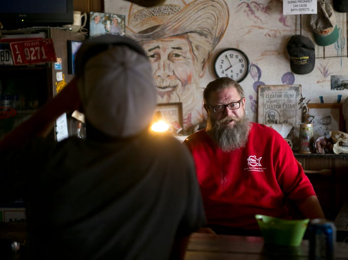 Dave Rhodes, 49, of Cleator, bartends at the Cleator Bar, in Cleator  on June 1, 2013. The town which currently has a population of just a handful of people dates back to the 1860s, born of miners, ranchers and railroad workers. The latter built Murphy's Impossible Railroad that transported gold from the mines in Crown King off the mountain. Cleator was the one stop along the line.