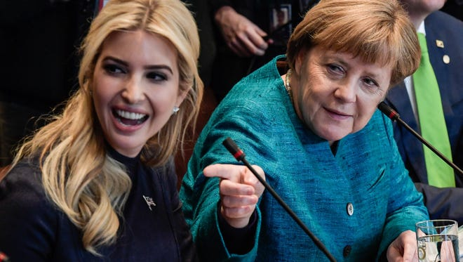 File photo taken in March 2017 shows Ivanka Trump (L) with German Chancellor Angela Merkel (R) at a White House joint discussion with business representatives.