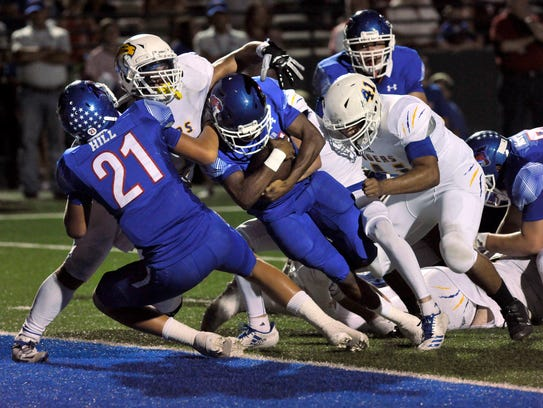 Cougar running back Maurice Johnson drives for the