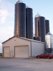 A  colony of Harvestore silos towers over other structures at Ruedinger Farms near Van Dyne.