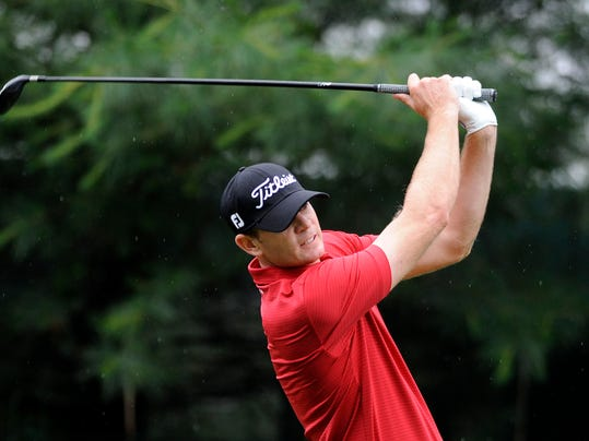 Brendan Steele watches his drive on the 10th tee during the first round of the Travelers Championship golf tournament in Cromwell, Conn., Thursday, June 19, 2014. (AP Photo/Fred Beckham)