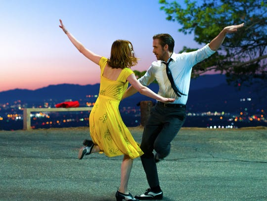 Ryan Gosling, right, and Emma Stone in a scene from,