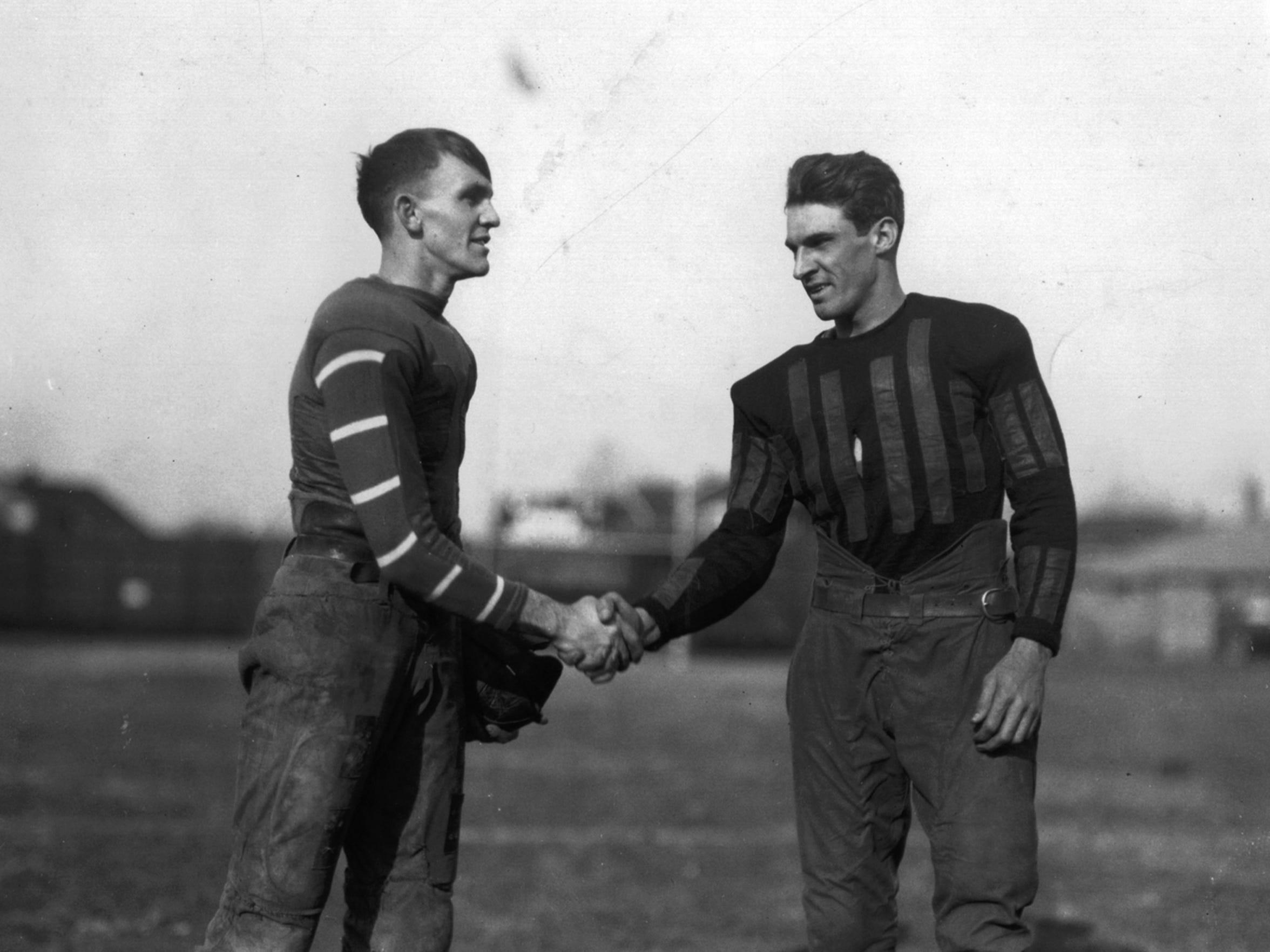 Vanderbilt quarterback Jess Neely, right, played with