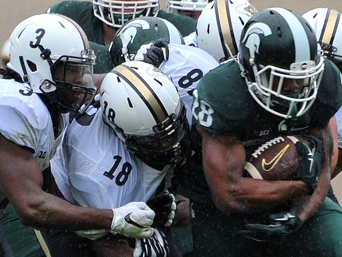 Michigan State running back Madre London tries to escape