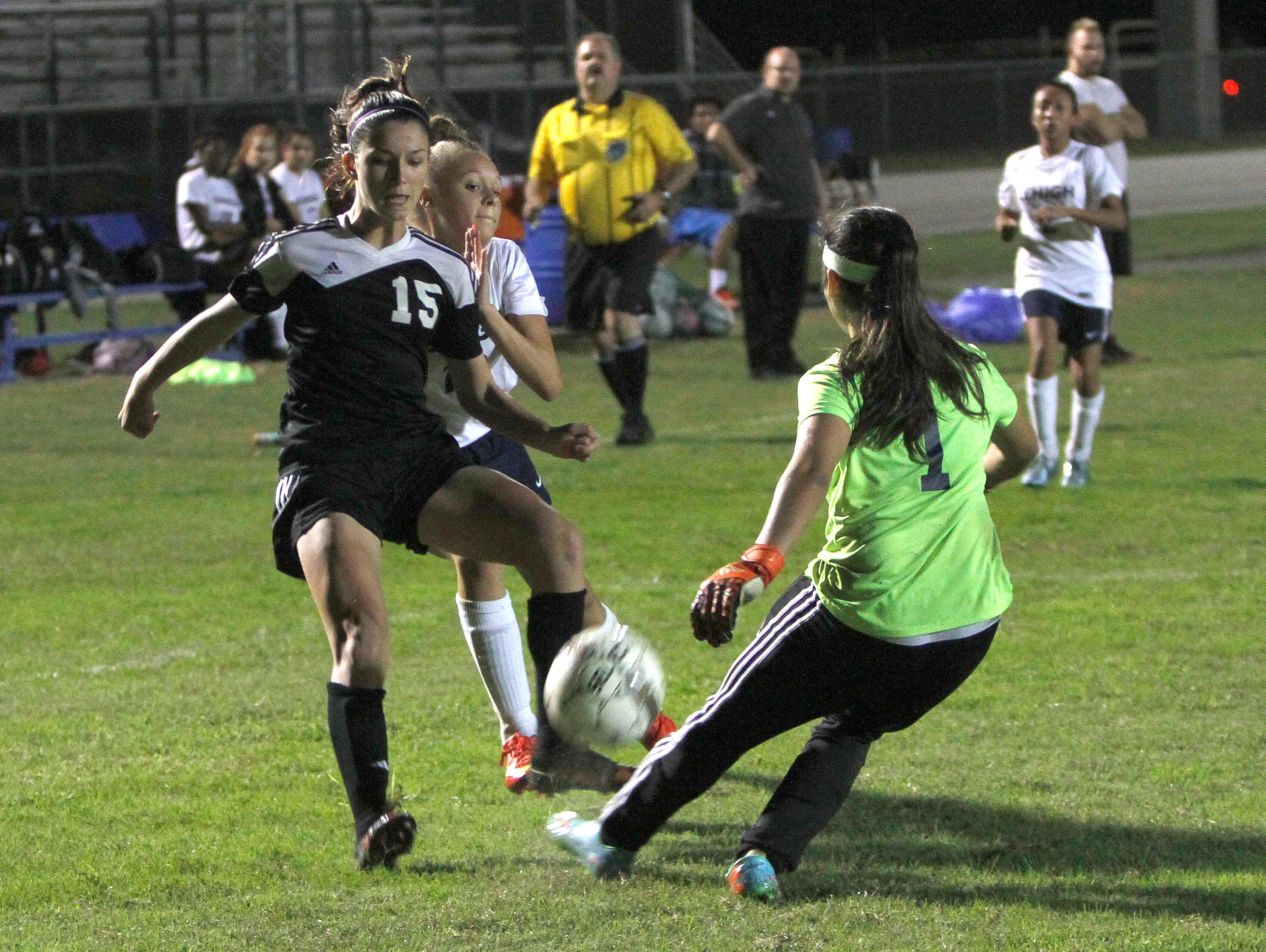 Mariner's Taylor Yount and Lehigh's Jessica White and Aileen Soto fight for possession Thursday in Lehigh Acres.