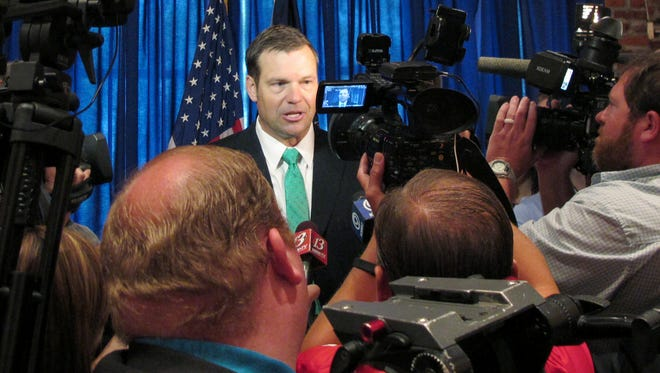Kansas Secretary of State Kris Kobach answers questions from reporters following the launch of his campaign for governor, Thursday, June 8, 2017, at an events center in Lenexa, Kan. Kobach is vice chairman of President Donald Trump's commission on election fraud and has advised Trump on immigration and voter fraud issues.