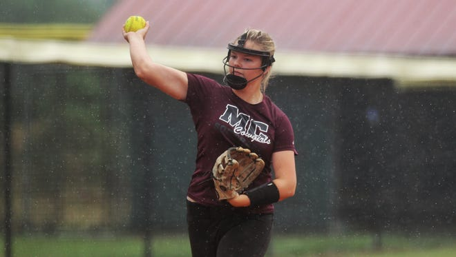 Madison County third baseman Abi Annett practices in the rain Monday. The Cowgirls' Class 1A state semifinal has been delayed six days due to bad weather in Vero Beach and across the state.