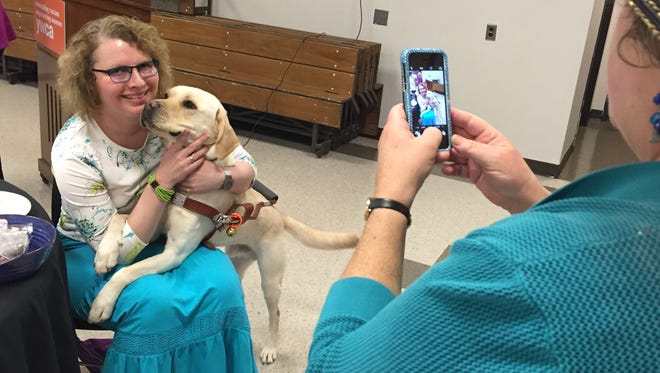 Kathy Nimmer, Indiana Teacher of the Year, poses for a photo with her service dog, Nacho, after a talk at the YWCA Greater Lafayette on Wednesday.
