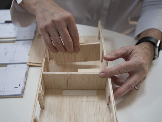 Laurie Davis builds a model in her studio on Thursday,