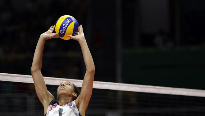 United States' Alisha Glass sets the ball during a women's preliminary volleyball match against Puerto Rico at the 2016 Summer Olympics in Rio de Janeiro, Brazil, Saturday, Aug. 6, 2016. (AP Photo/Matt Rourke)