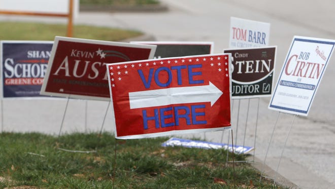 Campaign signs adorn a lawn outside of a south Springfield polling place.