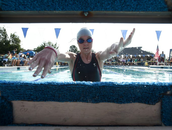 Riley Harrison, 12, from the Willow Springs Pool, lets go of the platform as she starts 50-yeard medley during the first day of the City Youth Swimming Championships at Westfield Swimming Pool Friday July 18, 2014.