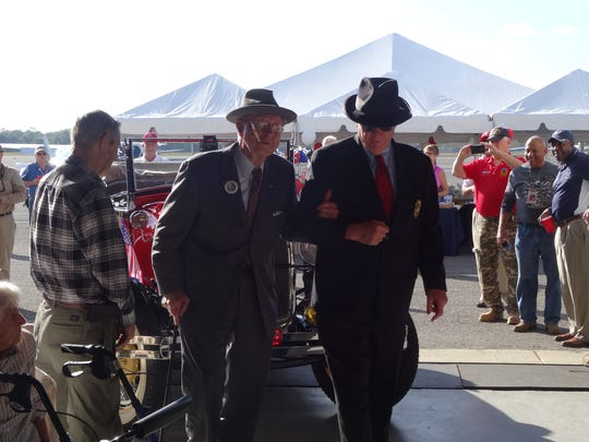 Delmas Wood, a Franklin D. Roosevelt reenactor, left, arrives with his Secret Service detail to Trident Home Loans' first Gulf Coast Pearl Harbor Day remembrance ceremony at the Pensacola Aviation Center.