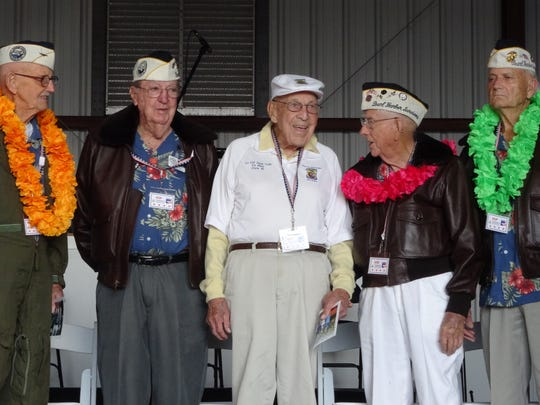 Pearl Harbor survivors and Doolittle Raider Richard Cole speak at Trident Home Loans' first Gulf Coast Pearl Harbor Day remembrance ceremony at the Pensacola Aviation Center. From left to right: Cass Phillips, Frank Emond, Richard Cole, Jay Carraway, Bill Braddock.