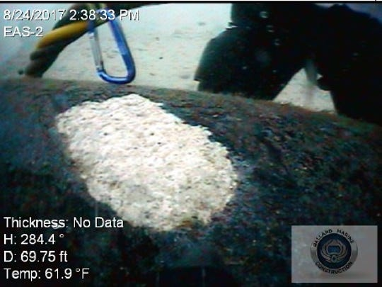 An image from underwater inspections of Line 5 in the Straits of Mackinac shows an area of missing protective coating and exposed steel.