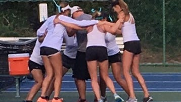 Members of the Gulf Coast High School girls tennis team celebrate winning the Class 3A state title on Tuesday, April 25, 2017, in Altamonte Springs.