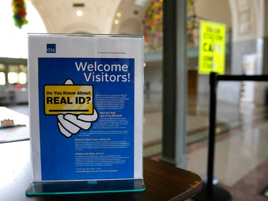 A sign at the federal courthouse in Tacoma, Wash., is shown to inform visitors of the federal government's REAL ID act, which requires state driver's licenses and ID cards to have security enhancements and be issued to people who can prove they're legally in the United States.