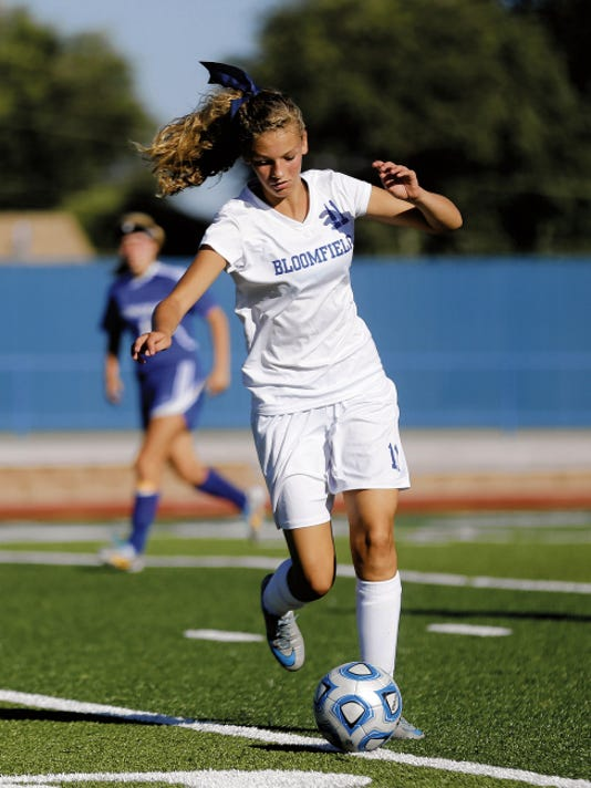 Bloomfield's Kenzie Massaro takes control of the ball against Bosque Saturday during a match at Bobcat Stadium in Bloomfield.