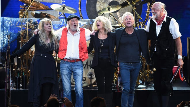 Fleetwood Mac band members take a bow, from left, Stevie Nicks, John McVie, Christine McVie, Lindsey Buckingham and Mick Fleetwood at the 2018 MusiCares Person of the Year tribute honoring Fleetwood Mac at Radio City Music Hall on Friday, Jan. 26, 2018, in New York. (Photo by Evan Agostini/Invision/AP) ORG XMIT: NYAH222