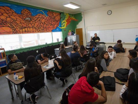 Alberto Prieto, center, a social studies teacher at