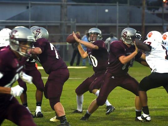 Shippensburg's Tyler Gustafson (10) looks to pass against East Pennsboro on Friday, September 19, 2014. Ryan Blackwell - Public Opinion