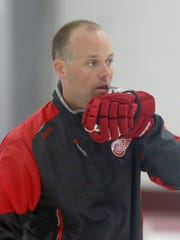 Red Wings coach Jeff Blashill blows the whistle he keeps on his glove during training camp on Sept. 19, 2015, in Traverse City.