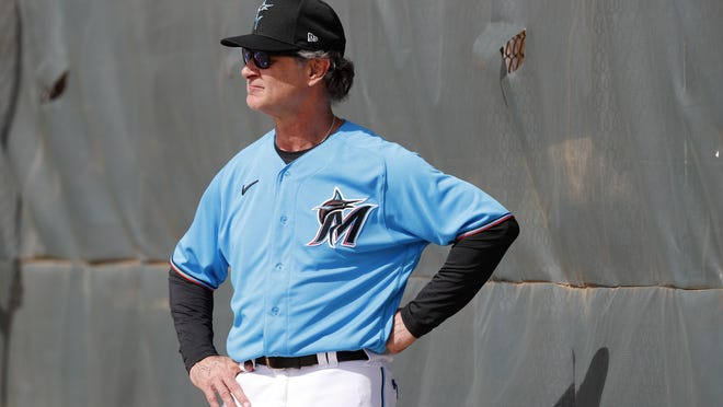 Miami Marlins manager Don Mattingly watches his team Wednesday, the first day pitchers and catchers to work out, in Jupiter.