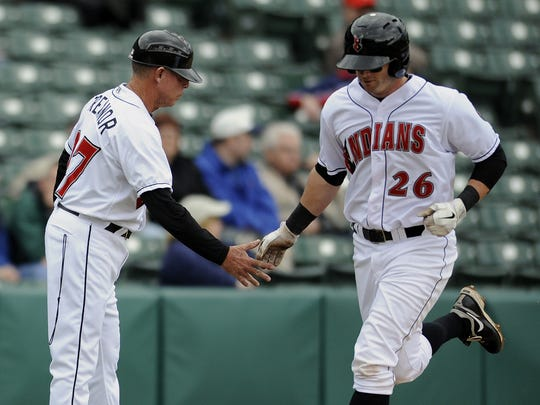 Manager Dean Treanor congratulates Matt Hague after hitting a home rum. The Victory bell rang as the Indianapolis Indians defeated the  Norfolk Tides, 7 to 6 at Victory Field.  Wednesday April 27, 2011.