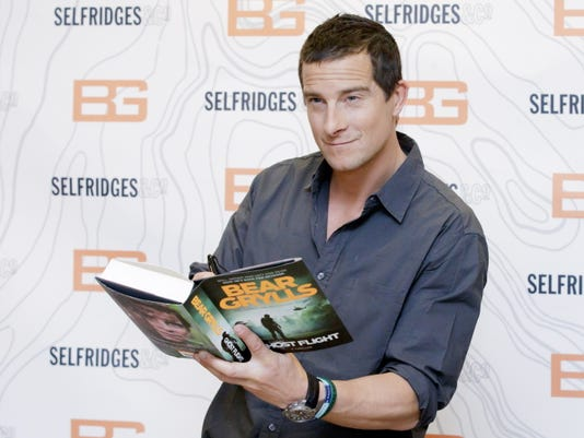 British writer and TV presenter Bear Grylls poses for photographers June 4 before signing copies of his new book at Selfridges in London.
