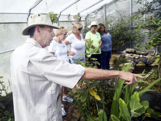 Vaughn Erickson talks a group of Franklin County Master Gardeners about the mating habits of the Monarch butterfly before releasing them for a migration period on Thursday, September 03, 2015. Ryan Blackwell   Public Opinion